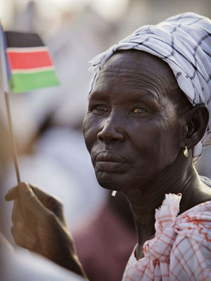 South Sudanese woman with flag
